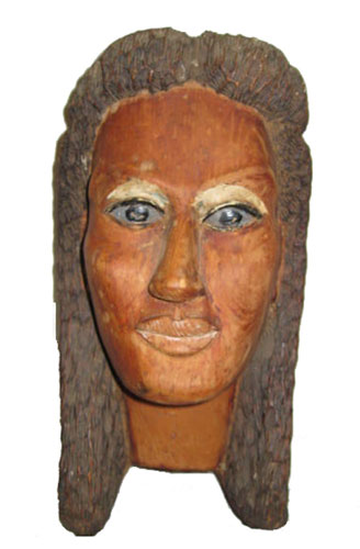 Woman's head carved in redwood by Floyd Davis Wood Sculptor